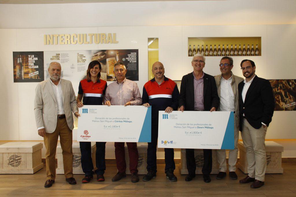 Down Málaga y Cáritas Donación Málaga Fundación Mahou San Miguel